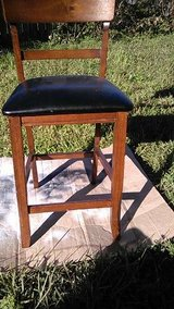 wood barstool with nrewly recovered black leather seat in Sugar Land, Texas