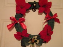 Christmas wreath. Poinsettias and Bows in Fort Hood, Texas