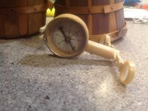 Celluloid Compass and vintage baskets in St. Charles, Illinois