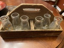 Primitive wooden carrier w/ 12 pint size dairy bottles in Aurora, Illinois