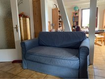 Couch with pull out bed and storage in Stuttgart, GE