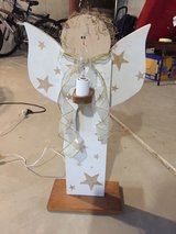 Wooden angel with lighted candle in Naperville, Illinois