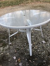 White glass top patio table in St. Charles, Illinois
