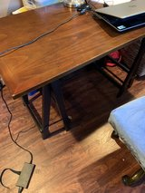 desk with brown finish and black legs in Fort Knox, Kentucky