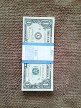 ONE STACK OF HUNDRED ONE DOLLAR NOTES in Tinley Park, Illinois
