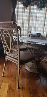 Beautiful glass table with 4 chairs. in Naperville, Illinois