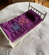 Wooden Bed and Sleeping bag in Naperville, Illinois