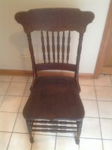 Six Antique Pressed back oak chairs in Chicago, Illinois
