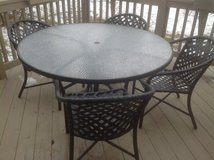 Brown Jordan Outdoor table, 8 Chairs, umbrella , weighted base in Bolingbrook, Illinois