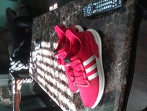 Red and white Adidas sneakers in Cherry Point, North Carolina
