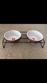 Ceramic pet bowls and metal stand in Clarksville, Tennessee