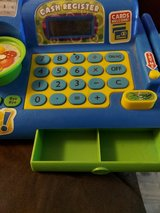kids play cash register in Alamogordo, New Mexico