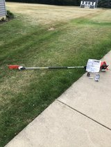 BRAND NEW ECHO STRAIGHT SHAFT POLE CAHIN SAW NEVER HAD GAS IN IT HAD MANUAL AND MISC PARTS in Naperville, Illinois
