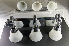 Pair of 3 light vanity bars with newer shades in Chicago, Illinois
