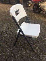 2 foldable chairs in Ramstein, Germany