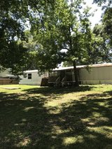 .5905 acre of land with 1998 Mobile Home in Baytown, Texas