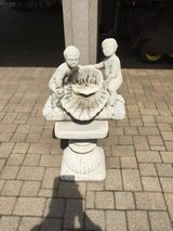 2 Concrete figures on base. Figures can be used as a fountain in Naperville, Illinois
