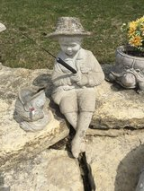 Concrete fisherman with fish and pole in Plainfield, Illinois