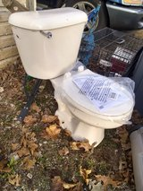 Bone colored toilet with insulated tank liner in Morris, Illinois