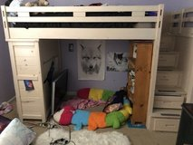 Loft bed with attached dresser and stairs. in Conroe, Texas