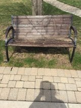 Large wood and heavy cast iron bench in Naperville, Illinois