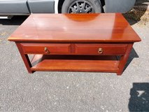 solid teak coffee table with two drawers. good condition, some scratches to the top. in Lakenheath, UK