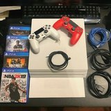 Playstation 4 slim white with controllers and games in Stuttgart, GE