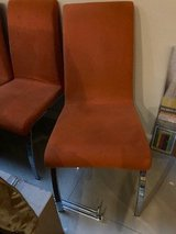 4 orange dining chairs in Spangdahlem, Germany