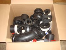 LOOK THRU A BOX OF FLEXIBLE RUBBER PIPING in Naperville, Illinois