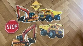 Paperboard construction vehicles to hang from the ceiling in Stuttgart, GE