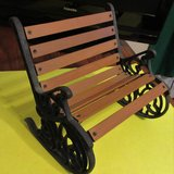 Vintage wood slat and wrought iron doll / bear bench in Fort Campbell, Kentucky