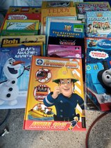 bundle of children's books and two games in Lakenheath, UK