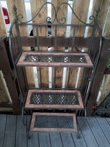 Wrought iron patio shelving / stand in Kingwood, Texas