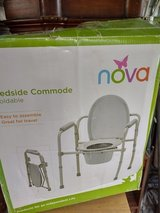 FOLDING  BEDSIDE COMMODE NEW IN BOX in Kingwood, Texas
