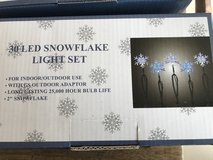 4 unopened boxes of blue and clear snowflake LED 220 volt lights in Ramstein, Germany