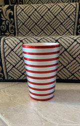 Red and silver vase in Kingwood, Texas