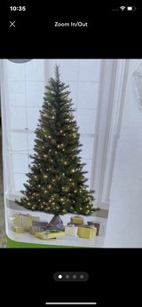 Like New 6.5ft Artificial Douglas Fir Christmas Pre-Lit Tree With 300 Clear Lights & Plastic Stand in San Diego, California